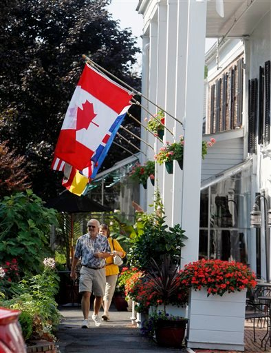 People walk in front of the Beekman Arms Inn in Rhinebeck, N.Y., Wednesday, July 28, 2010. Chelsea Clinton plans to marry fiance Marc Mezvinsky in the upstate New York village of Rhinebeck on Saturday.  (AP Photo/Mike Groll)