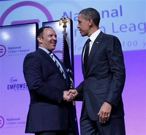 President Barack Obama is greeted by National Urban League President and CEO Marc Morial before addressing the National Urban League 100th Anniversary Convention in Washington, Thursday, July 29, 2010. (AP Photo/Pablo Martinez Monsivais)
