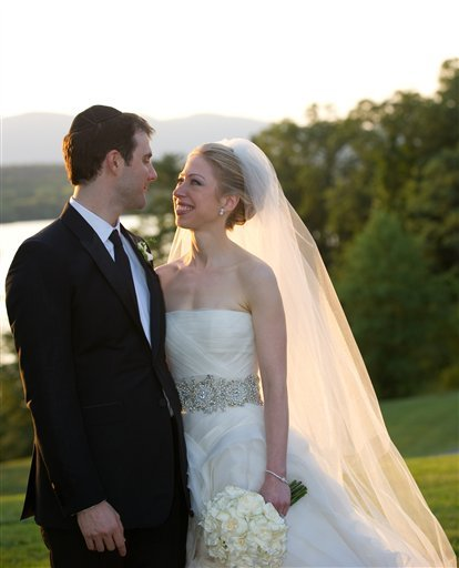 In this photo provided by Genevieve de Manio Photography, Chelsea Clinton and Marc Mezvinsky are seen during their wedding, Saturday, July 31, 2010 in Rhinebeck, N.Y.  Chelsea Clinton wed her longtime boyfriend under extraordinary security at an elegant Hudson River estate late Saturday. (AP Photo/Genevieve de Manio ) NO SALES