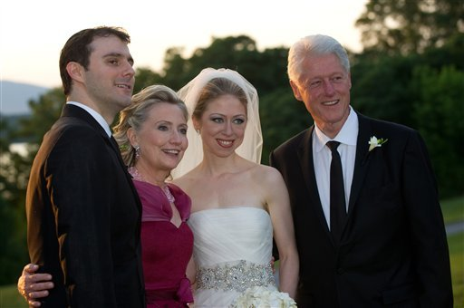 This photo released by Genevieve de Manio Photography shows Marc Mezvinsky,left with his new mother-in-law Hillary Rodham Clinton, his bride Chelsea and father-in-law former President Bill Clinton after the couples wedding Saturday July 31, 2010 in Rhinebeck,N.Y. (AP Photo/Genevieve de Manio Photography,Barbara Kinney)**NO SALES**