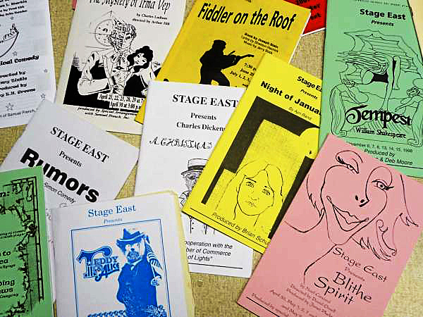Some of the programs from dozens of productions that the Stage East community theater of Eastport has staged over the past 20 years. (Bangor Daily News/Sharon Mack)