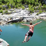 "Ricky Palmer, 18, (left) of Winterport watches as Nick Adams, 16, of Frankfort jumps off a ledge at the Mt. Waldo Quarry on Sunday, Aug. 1, 2010, a popular swimming hole where a woman died Saturday. Amy Willey, 39, of Bucksport was killed when she jumped from a similar ledge and failed to resurface. ""I hope they don't shut it down,"" Adams said in between jumps Sunday. ""We swim up here all the time, all summer."" (Bangor Daily News/Bridget Brown)"