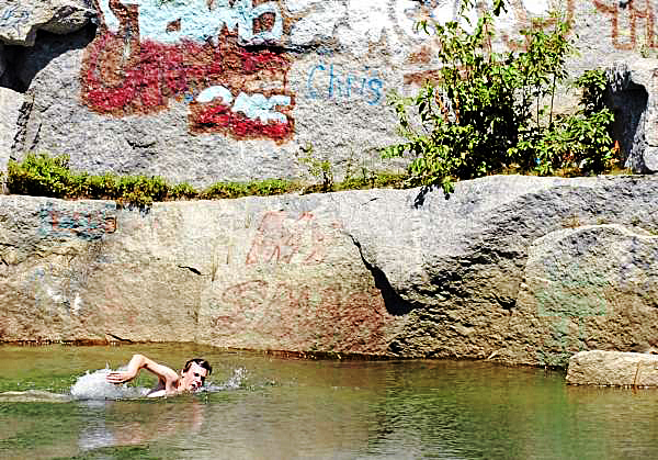 Zack Skolfield, 20, of Bangor swims after jumping off a ledge at the Mt. Waldo Quarry on Sunday, Aug. 1, 2010, a popular swimming hole where a woman died Saturday. Amy Willey, 39, of Bucksport was killed when she jumped from a similar ledge and failed to resurface. (Bangor Daily News/Bridget Brown)