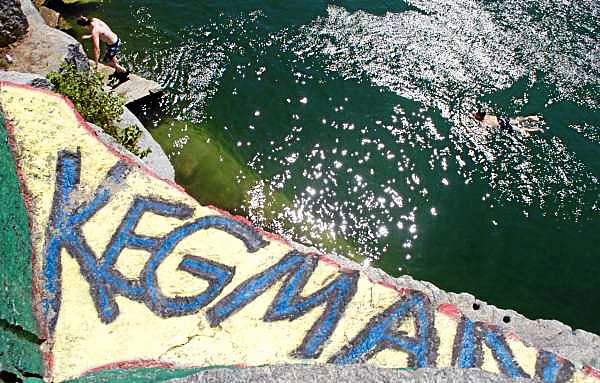Zack Skolfield, 20, (left) of Bangor climbs a ledge as Nick Adams, 16, of Frankfort swims after jumping a 30 to 40-foot cliff at the Mt. Waldo Quarry on Sunday, Aug. 1, 2010, a popular swimming hole where a woman died Saturday. Amy Willey, 39, of Bucksport was killed when she jumped from a similar ledge and failed to resurface. (Bangor Daily News/Bridget Brown)