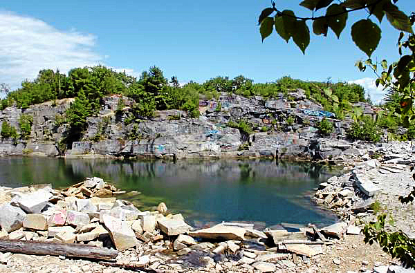 The Mt. Waldo Quarry is seen on Sunday, Aug. 1, 2010, a popular swimming hole where a woman died Saturday. Amy Willey, 39, of Bucksport was killed when she jumped from a similar ledge and failed to resurface. (Bangor Daily News/Bridget Brown)