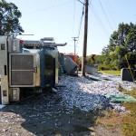Truck rolls over,  spilling herring and fuel