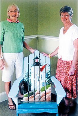 Karen &quotDrifty&quot Perry (left) and Felice Janes of Harbor House with the &quotBass Harbor Head Light&quot chair by Belinda Lawson.