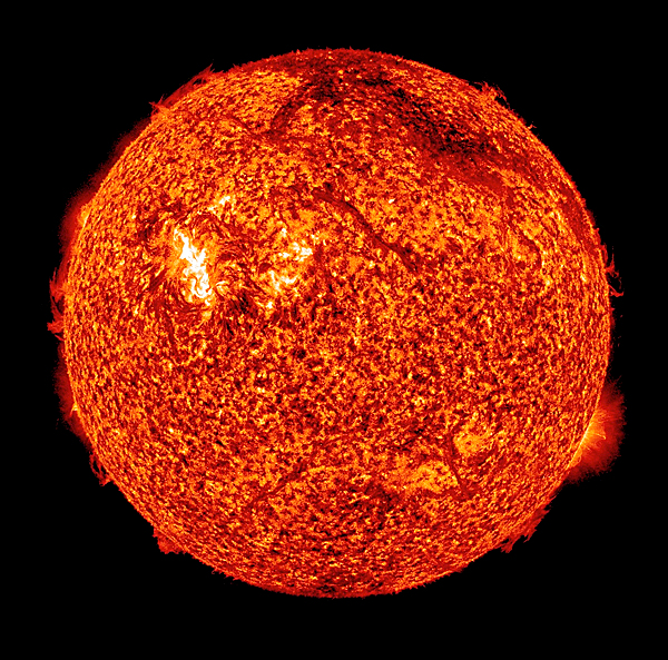 In this x-ray photo provided by NASA, the sun is shown early in the morning of Sunday, Aug. 1, 2010. The dark arc near the top right edge of the image is a filament of plasma blasting off the surface _ part of the coronal mass ejection. The bright region is an unassociated solar flare. When particles from the eruption reach Earth on the evening of Aug. 3-4, they may trigger a brilliant auroral display known as the Northern Lights. (AP Photo/NASA)