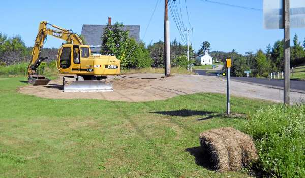 The scene of the Saturday lobster-bait herring truck rollover in Whiting has been cleaned up and damage to Esther MacLaughlin's yard repaired, as seen in this Monday, August 2, 2010 photo by her daughter, Robin McPhail. After this photo was taken, the lawn was reseeded, also. (Photo courtesy of Robin McPhail)