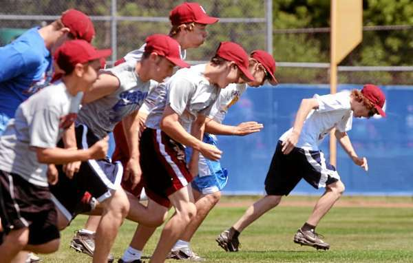 Members of the Bangor Junior League baseball team warm up during a workout at the Mansfield Stadium in Bangor.  The team is preparing fof the Junior League New England tourney. (Bangor Daily News/Gabor Degre)
