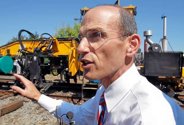 Maine Gov. John Baldacci makes comments as new rail is laid next to old tracks  in Brunswick, Maine, on Monday, Aug. 2, 2010, during a ceremony. The rail line that will connect Brunswick to Portland, Maine, is scheduled to be completed  by 2012, said Baldacci. (AP Photo/Pat Wellenbach)