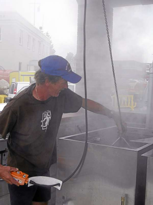 Peter Smith, of Rockland, is the head chef of the Maine Lobster Festival. Smith stood Tuesday in a cloud of steam as he cleaned the eight lobster cookers. The Maine Lobster Festival steams the bugs and does not boil them. &quotBy the end, I will have all sorts of steam burns all over me,&quot Smith said Tuesday. He has volunteered at the festival on and off for 20 years.   BANGOR DAILY NEWS PHOTO BY HEATHER STEEVES