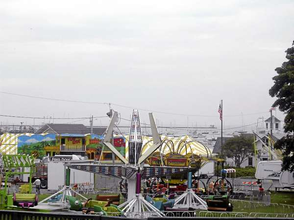Rides, games and vendor tents finished setting up against a misty Rockland harbor Tuesday. The Maine Lobster Festival runs from Aug. 4-8.  BANGOR DAILY NEWS PHOTO BY HEATHER STEEVES