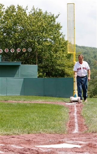 Pat O'Connor lines the right field line at Little Fenway, a scaled-down version of the major league field in Essex, Vt., Monday, Aug. 2, 2010. Little Fenway is a unique 1/4th scale replica of Boston's Fenway Park in the backyard of Pat & Beth O'Connor's house in Essex, Vermont. It was built in 2001 and is used exclusively for Wiffle ball games. (AP Photo/Toby Talbot)