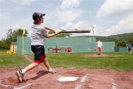 A youngster takes a swing at the plate at Little Fenway, a scaled-down version of the major league field in Essex, Vt., Monday, Aug. 2, 2010. Little Fenway is a unique 1/4th scale replica of Boston's Fenway Park in the backyard of Pat & Beth O'Connor's house in Essex, Vermont. It was built in 2001 and is used exclusively for Wiffleball games. (AP Photo/Toby Talbot)