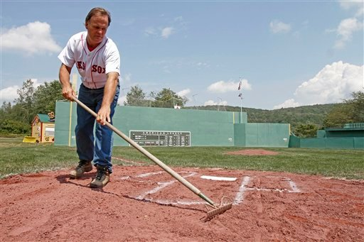 Pat O'Connor rakes around home plate at Little Fenway, a scaled-down version of the major league field in Essex, Vt., Monday, Aug. 2, 2010. Little Fenway is a unique 1/4th scale replica of Boston's Fenway Park in the backyard of Pat & Beth O'Connor's house in Essex, Vermont. It was built in 2001 and is used exclusively for Wiffleball games. (AP Photo/Toby Talbot)