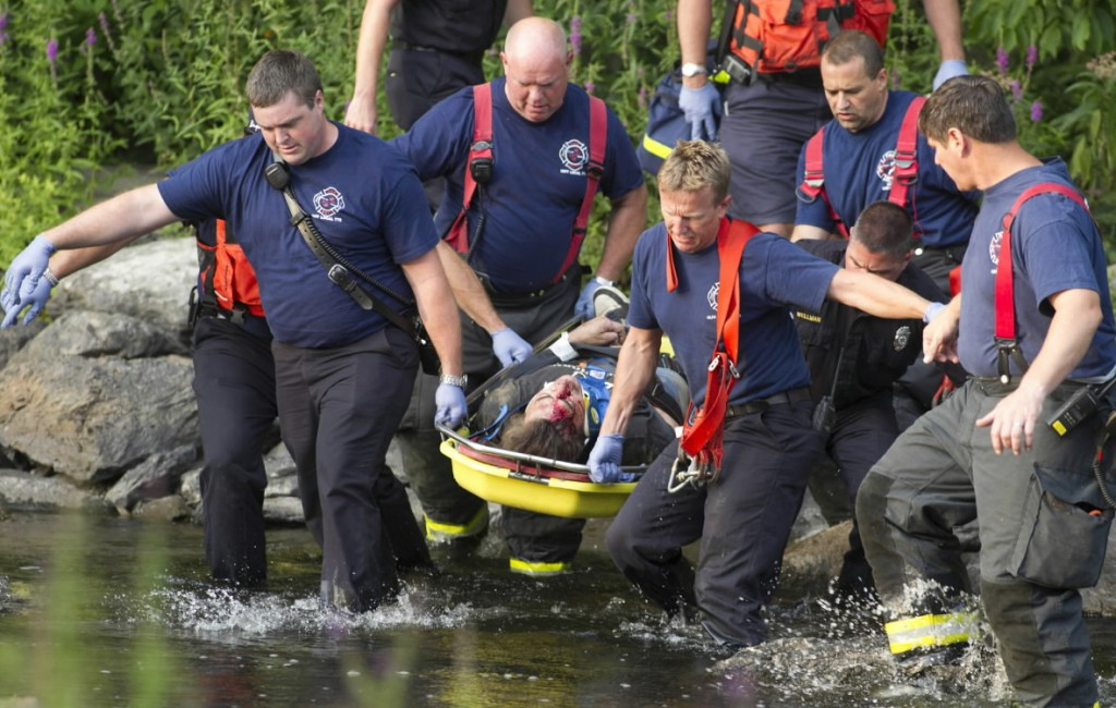 Bangor Firefighters (L. to R. front to back ) Corey Wyman, Brent Grover, Lt. McCray, Dave Dowe, Capt. Rollins, Joe Wellman, Capt. Rotanno carry an injured across Kenduskeag Stream after fell down the embankment also known as &quotLovers Leap&quot.  Photo By: Monty J. Rand 207-990-3456 office 207-561-0807 Cell   I don't have correct spellings on the names. I know the firefighters would appreciate being listed in the paper. It's a big deal to them. If needed, I can try to get more Info.
