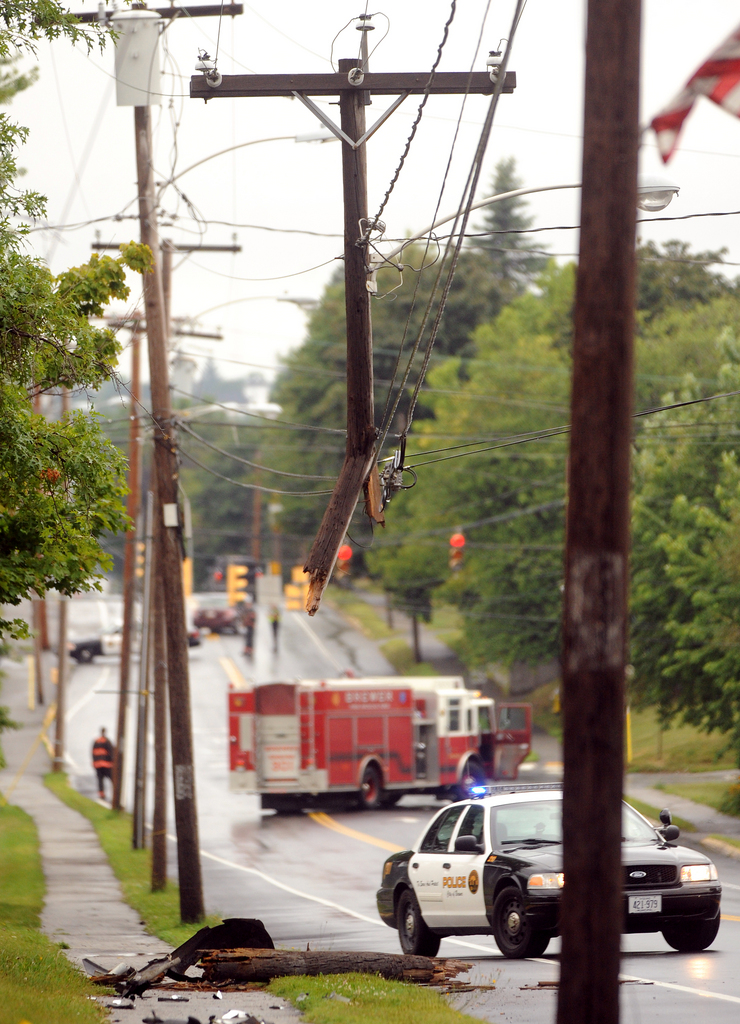 A minivan clipped a utility pole on State Street in Brewer Wednesday morning. The road was closed until crews repaired the damage. (Bangor Daily News/Gabor Degre)