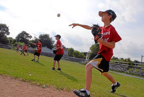 Jacob Ireland, 12, (foreground) of Bangor and his Bangor East teammates practice Wednesday afternoon, August 4, 2010 at Taylor Field in Bangor for their upcoming appearance at the the New England 11-12 regional in Bristol, CT later this week. (Bangor Daily News/John Clarke Russ)