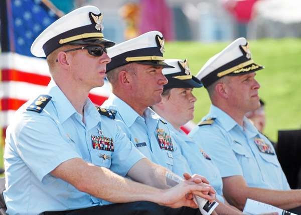 U.S. Coast Guard members including (from left) Chief Warrant Officer Sebastian Arnsdorf, Chief Warrant Officer 4 Paul Dupuis, Lt. Brierley Ostrander and Commander Brian Gilda listen during a ceremony honoring the 220th birthday of the U.S. Coast Guard at the 63rd annual Maine Lobster Festival in Rockland on Wednesday, Aug. 4, 2010. (Bangor Daily News/Bridget Brown)