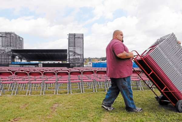 Mike Cyr of Hampden, an employee with Winterport-based Seven Oaks Training Center, helps with the placement of some of the 8000 collapsible seats brought to Bangor's waterfront for Thursday evening's Lynyrd Skynyrd/ Charlie Daniels concert. Photographed Wednesday afternoon, August 4, 2010. (Bangor Daily News/John Clarke Russ)