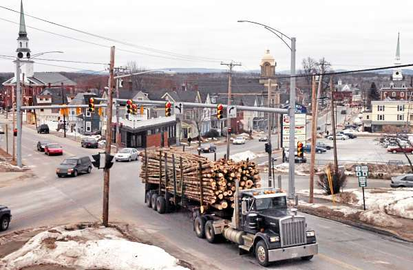 A log truck heads west on Hammond Street after turning from Union Street in Bangor last week. Gov. John Baldacci signed an emergency bill Jna. 23 which increased weight limits from 100,000 pounds to 105,000 pounds for six-axle trucks until April 1 to ease the strain of high diesel fuel prices. Some transportation experts say the 5 percent weight increase translates to a 35 percent to 40 percent increase in damage to Maine roads.  (BANGOR DAILY NEWS PHOTO BY BRIDGET BROWN)  CAPTION  A log truck heads west on Hammond Street after turning from Union Street in Bangor on Friday, Feb. 1, 2008. Gov. John Baldacci signed an emergency bill Jan. 23 which increased weight limits from 100,000 pounds to 105,000 pounds for six-axle trucks until April 1 to ease the strain of high disel-fuel prices. Some transportation experts say this 5 percent weight increase translates to a 35 to 40 percent increase in damage to the road. (Bangor Daily News/Bridget Brown)