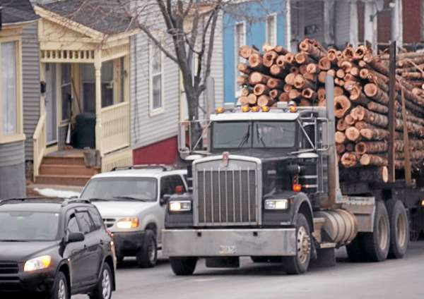 A log truck waits at a red light in Bangor in 2008.  (BANGOR DAILY NEWS PHOTO BY BRIDGET BROWN)  CAPTION  A log truck waits at a red light on Union Street in Bangor near the intersection with Hammond Street on Friday, Feb. 1, 2008. The state Legislature is currently considering a bill which would increase weight limits from 100,000 pounds to 105,000 pounds for six-axle trucks until April 1 to ease the strain of high diseal-fuel prices. (Bangor Daily News/Bridget Brown)
