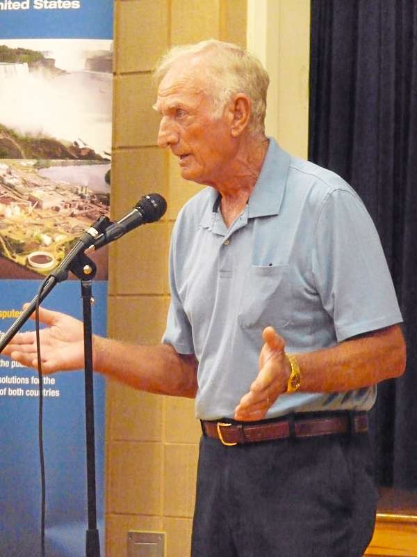Harry Bailey, who has owned a hunting and fishing lodge in Grand Lake Stream for decades, speaks to the International Joint Commission studying alewife migration in the St. Croix watershed Wednesday night at Princeton. Bailey, who opposes the IJC's plan to allow alewife to migrate to Grand Lake, said there were no alewife in the area prior to the blasting of a natural dam at Milltown in 1981 by the Canadian government. &quotBefore we can even comment on this plan, we need proof that the alewife were there before that,&quot Bailey said. About 110 people attending the forum, representing conservationists, biologists, sport and commercial fishermen. BANGOR DAILY NEWS PHOTO BY SHARON KILEY MACK