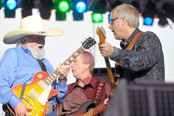 Charlie Daniels. left,  jams out with bandmates Charlie Hayward, center, and Bruce Brown, right, during their concert opener for Lynyrd Skynyrd on Bangor's Waterfront Thursday evening. (Bangor Daily news/John Clarke Russ)