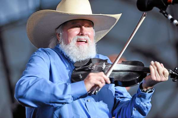 Charlie Daniels. left, works his fiddle during his band's concert opener for Lynyrd Skynyrd on Bangor's Waterfront Thursday evening. (Bangor Daily news/John Clarke Russ)