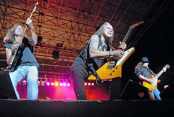 Left to right: Lynyrd Skynyrd bandmates  Mark &quotSparky&quot Matejka, Ricky Medlocke and Gary Medlocke share guitar licks at the beginning of their concert  in front of thousands of devoted fans on Bangor's waterfront Thursday evening, August 5, 2010. (Bangor Daily News/John Clarke Russ)