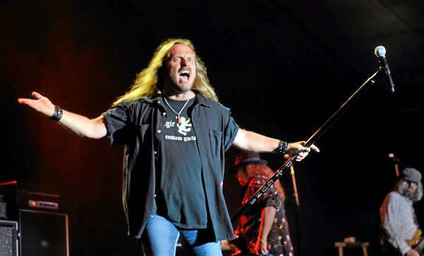 Johnny Van Zant of Lynyrd Skynyrd gets the crowd fired up at the beginning of their concert on Bangor's waterfront Thursday evening, August 5, 2010. (Bangor Daily News/John Clarke Russ)