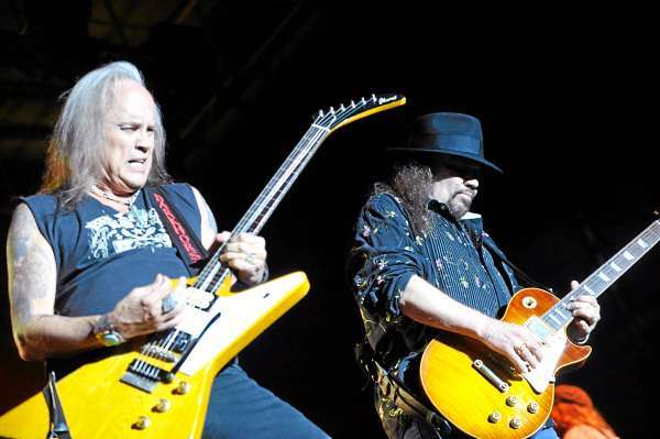 Ricky Medlocke, left, and Gary Rossington of Lynyrd Skynyrd  share guitar licks at the beggining of their concert  in front of thousands of devoted fans on Bangor's waterfront Thursday evening, August 5, 2010. (Bangor Daily News/John Clarke Russ)