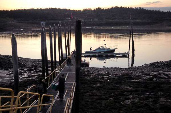 New England Aquarium researchers board the Nereid in Lubec at dawn before departing for the Bay of Fundy to look for right whales Thursday. The researchers have been coming to Lubec for 30 years to do their work.  (BANGOR DAILY NEWS PHOTO BY BRIDGET BROWN)  CAPTION  New England Aquarium researchers board the Nereid in Lubec at dawn before departing for the Bay of Fundy to look for right whales Thursday, Aug. 20, 2009. The researchers have been coming to Lubec for 30 years to do their work. (Bangor Daily News/Bridget Brown)
