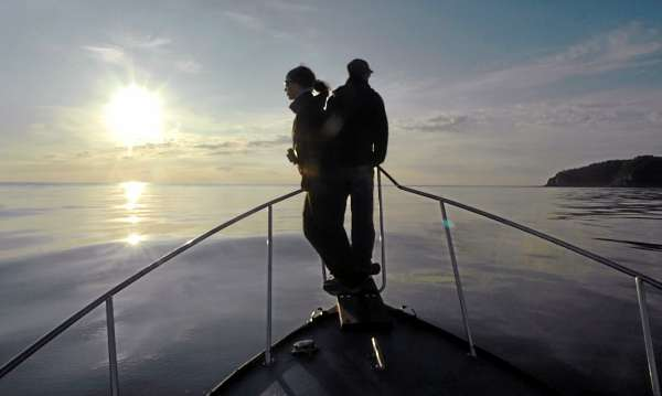 New England Aquarium researchers Jessica Taylor (left) and Jon Cunha watch for North Atlantic right whales and other marine life as they conduct a survey in the Bay of Fundy near Grand Manan (right) on Thursday at dawn. Once hunted to the brink of extinction, critically endangered right whales migrate each summer north on the Atlantic seaboard from their birthing area near the Florida or Georgia coast to the Bay of Fundy where they feed and socialize. Scientists from the aquarium have summered in Lubec for 30 years to conduct research on the species, which is thought to include less than 450 whales.  (BANGOR DAILY NEWS PHOTO BY BRIDGET BROWN)  CAPTION  New England Aquarium researchers Jessica Taylor (left) and Jon Cunha watch for North Atlantic right whales and other marine life as they conduct a survey in the Bay of Fundy near Grand Manan (right) on Thursday, Aug. 20, 2009 at dawn. Once hunted to the brink of extinction, the critically endangered right whale migrates each summer up the Atlantic seaboard from their birthing area near the Florida or Georgia coast, to the Bay of Fundy where they feed and socialize. Scientists from the aquarium have summered in Lubec for the past 30 years to conduct their research on the species which is thought to include less than 400 whales. (Bangor Daily News/Bridget Brown)