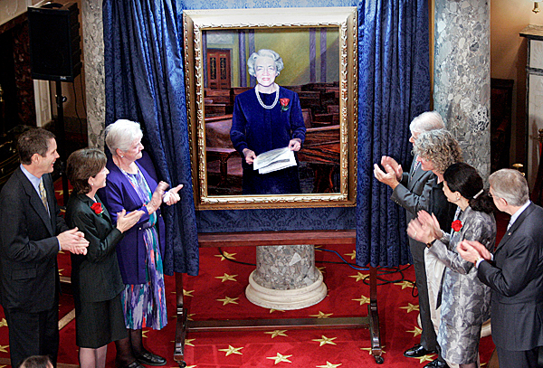 Dignitaries applaud the unveiling of a portrait of former Maine Republican Sen. Margaret Chase Smith at the Capitol in Washington on Tuesday. Attending are (from left) House Majority Leader Bill Frist of Tennessee; Maine Sen. Susan Collins; Anne St. Ledger Herrin; John Bernier; Ronald Frontin, the South Thomaston artist who painted the portrait; Maine Sen. Olympia Snowe; and Senate Minority Leader Harry Reid of Nevada.  (AP Photo/Lawrence Jackson)