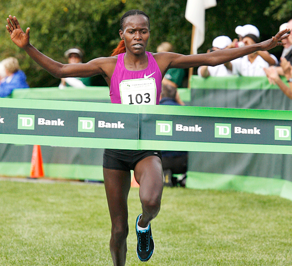 Lineth Chepkurui, of Kenya, crosses the finish line Saturday, Aug. 7, 2010 to win the 13th annual TD Bank Beach To Beacon 10K road race in Cape Elizabeth, Maine. (AP Photo/Joel Page)