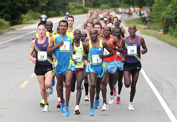Elite runners compete in the 13th annual TD Bank Beach To Beacon 10K road race Saturday, Aug. 7, 2010, in Cape Elizabeth, Maine. Gebre Gebremariam, (7), of Ethiopia, second from left,  went on to win the race, followed by Alan Kiprono, (17), of Kenya, second from left, in second place. AP PHOTO BY JOEL PAGE