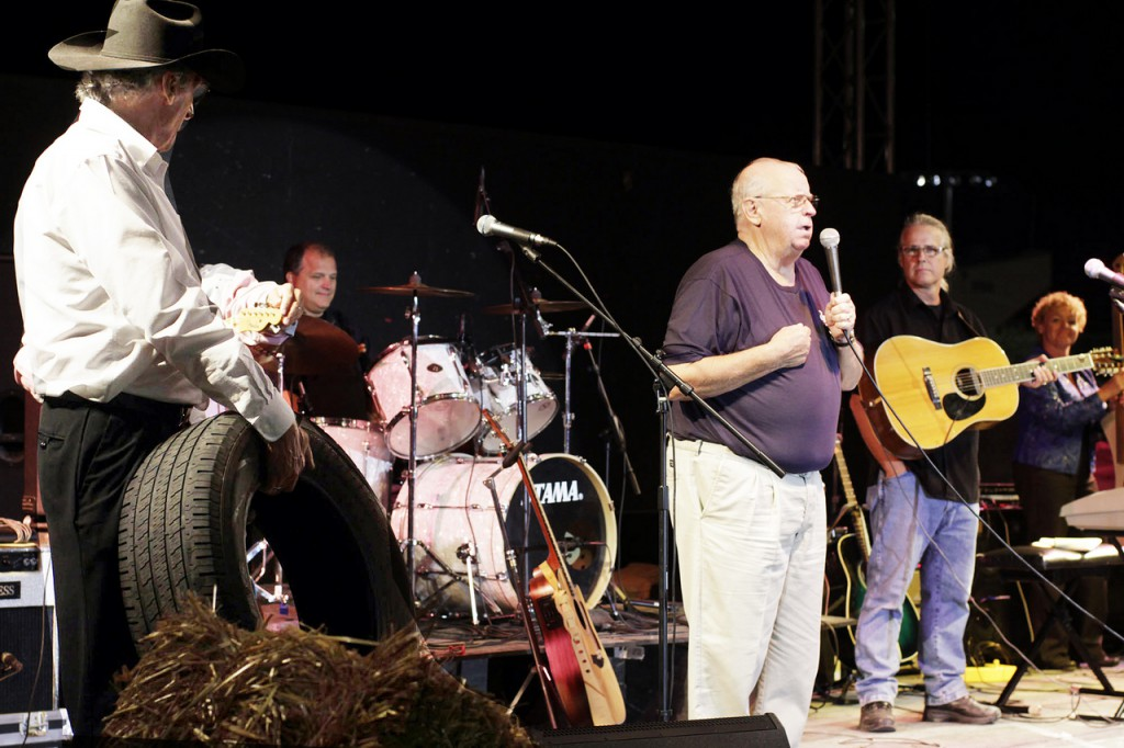Dick Stacey says a few words to fans of his former television show at the Bangor State Fair grandstand Saturday.