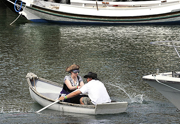 Opting for a cruise around the slips at the Rockland waterfront were Libby 'the Corsair' and Jameel Akari from Troy, New York. The two were competing in the Blindfolded Boat Race as part of the Lobster Fest, Saturday, August 7, 2010. (Bangor Daily News/Michael C. York)