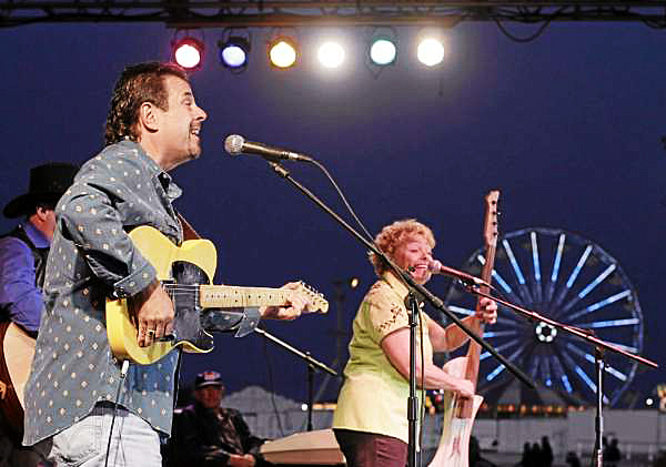 Norm and Debbie Pelletier perform at the grandstand of the Bangor State Fair as  part of the Stacey's reunion Saturday, Aug. 7, 2010. (Bangor Daily News/Michael C. York)