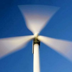 In this Sunday, July 19, 2009 photo, the blades of windmill blur as they catch the wind on Stetson Mountain in Range 8, Township 3, Maine. (AP Photo/Robert F. Bukaty)