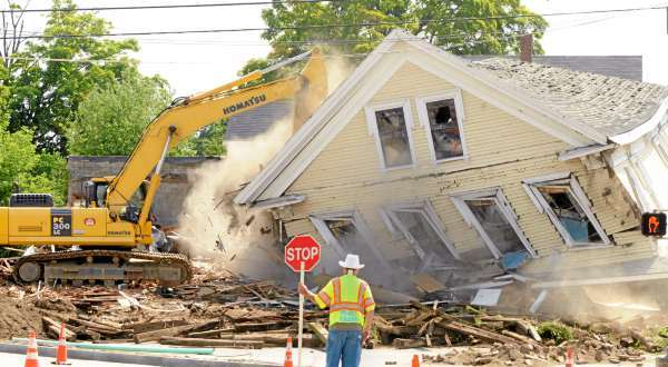 One of the buildings on the Archer Block is knocked down by an excavator on the corner of Wilson Street and North Main St. in Brewer Monday morning, August 9, 2010.  (Bangor Daily News/Gabor Degre)  WITH RICKER STORY.