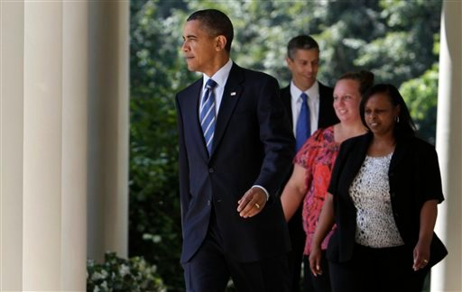 President Barack Obama,  followed by educators Rachel Martin, in the black blazer, Shannon Lewis, in pink, and Education Secretary Arne Duncan , walks to the Rose Garden at the White House in Washington, Tuesday, Aug. 10, 2010. (AP Photo/Carolyn Kaster)