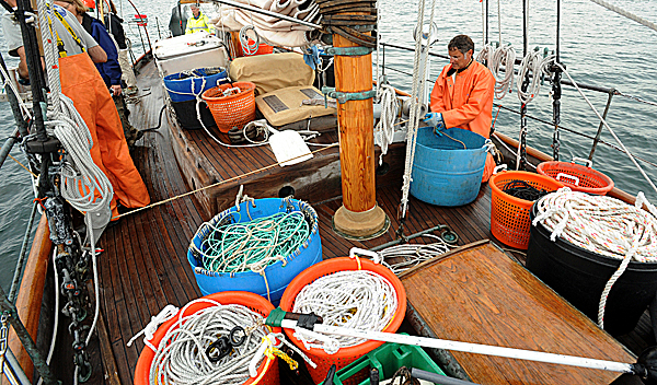 (BANGOR DAILY NEWS PHOTO BY GABOR DEGRE)CAPTIONFishing gear covers the deck of the 56 foot wooden schoner the Alert as it hauls trawl lines in Frenchman Bay near Jordan Island Tuesday.  Captain Roger Woodman's (right) boat is the platform for a study to compare groundfish stock using the traditional fishing methods and will compare the size of the catch to fishing vessel log books from the 1860's.  The study is a collaboration between MDI Biological Laboratory, the University of New Hampshire and other researchers and organzations. (Bangor Daily News/Gabor Degre)
