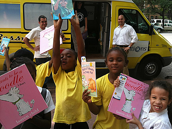 Bess the Book Bus spends the day in Harlem, N.Y., on June 23. The bus is filled with children's books. Jennifer Frances
