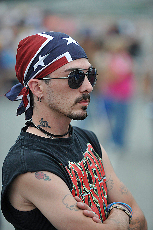 Jeremy Joseph Santos of Winslow, Maine  proudly wears his Lynyrd Skynyrd colors as he looks for faces in the crowd before the start of the Charlie Daniels-Lynyrd Skynyrd concert on Bangor's waterfront Thursday evening, August 5, 2010. Santos said he has a cousin who plays in a well-known Synyrd tribute band in Rhode Island. (Bangor Daily News/John Clarke Russ)