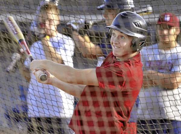 Curtis Worcester takes a few practice pitches in the batting cage at Mansfield Stadium Thursday, August 12, as the Bangor Senior League All Stars prep for the upcoming tournament. Bangor Daily News/Michael C. York