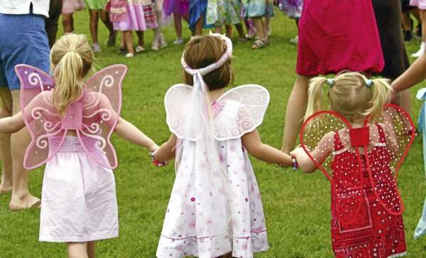 Fairies3: Three girls hold hands for the &quotDance of the Four Elements&quot during the Maine Fairy House Festival on Saturday, Aug. 7 at the Coastal Maine Botanical Gardens in Boothbay. (Bangor Daily News/Aislinn Sarnacki)