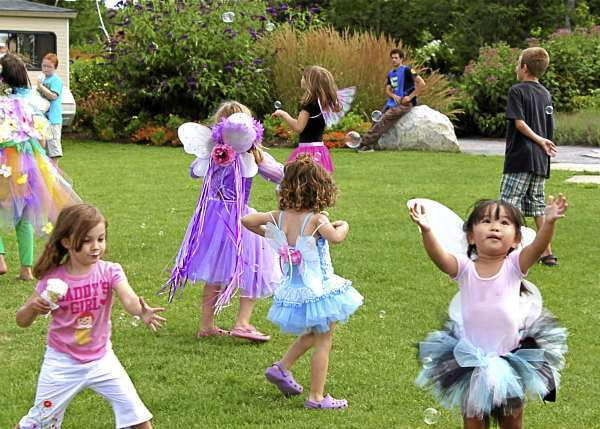 Fairies1: Children catch bubbles and eat icecream during the Maine Fairy House Festival on Saturday, Aug. 7 at the Coastal Maine Botanical Gardens in Boothbay. (Bangor Daily News/Aislinn Sarnacki)